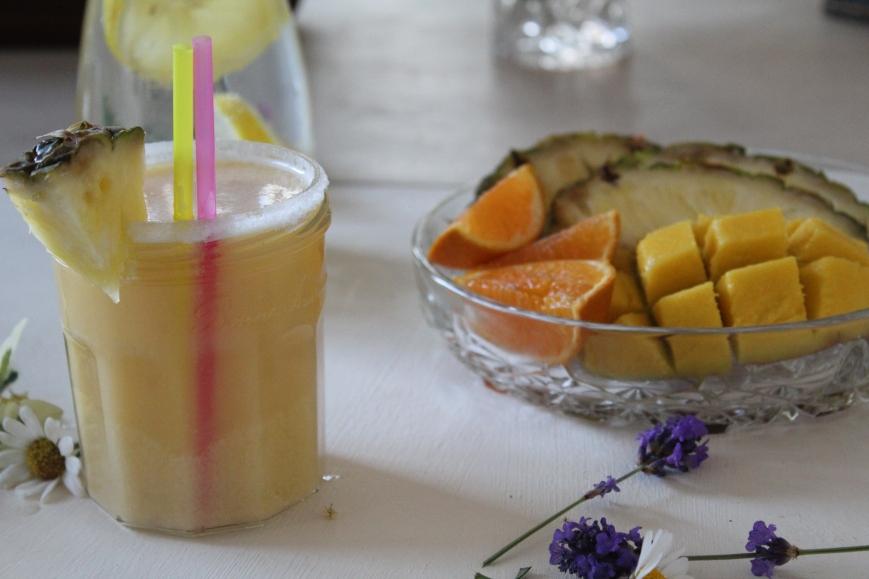 Fruit platter with mango, orange, pineappe, strawberries and lemon.