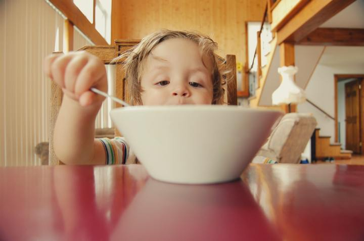 Child eating a bowl of cereal.