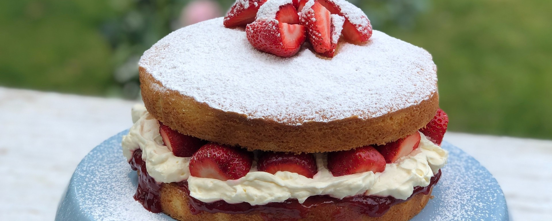 Gluten Free Sponge Cake with strawberry jam, fresh cream and chopped fresh strawberries