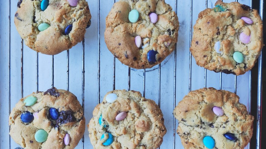 Smarties Cookies. Six cookies on a tray.